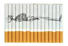 Rauchende Tötungen Begriffsbild auf Zigaretten Stockbilder