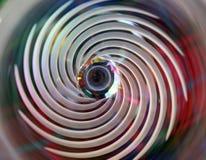 Rauchige Glasspirale mit buntem Hintergrund lizenzfreie stockfotos
