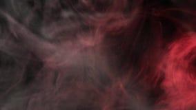 Rauchwolken belichtet durch farbiges Licht stock video footage