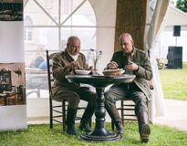 Retired soldiers in authentic outfit having lunch during national festival in Raudondvaris, Lithuania