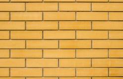 Raue beige Backsteinmauer Stockbild