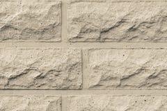 Raue Betonmauer der beige Farbe Stockfotos