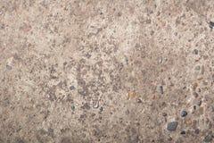 Raue Zementbeschaffenheit mit Felsen Stockfoto