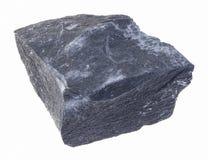 rauer schwarzer Argillitestein (Schlammstein) auf weißem stockfotografie