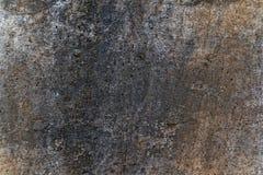Raues schwarzes braunes und graues Betonmauerbeschaffenheitsfoto stockbilder
