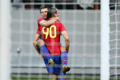 FC Steaua Bucharest- FC Gaz Metan Medias. Raul Rusescu hugging Stefan Nikolici after scoring a goal, during the football match, counting for the Romanian League Royalty Free Stock Photo