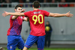 FC Steaua Bucharest- FC Gaz Metan Medias. Raul Rusescu hugging Stefan Nikolici after scoring a goal, during the football match, counting for the Romanian League Royalty Free Stock Images