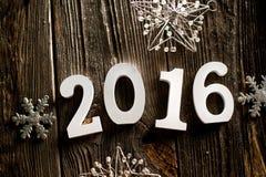Raum 2016 auf dem hölzernen Hintergrund Stockfoto