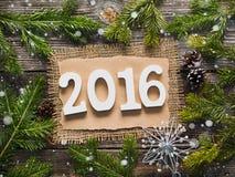 Raum 2016 auf dem hölzernen Hintergrund Stockfotografie