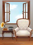 Raum mit weißem Lehnsessel und Weinlesetelefon Stockfoto