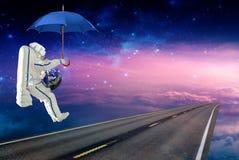 Raumfahrer auf dem Regenschirm und Erddem reisen lizenzfreie stockfotos