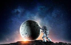 Raumfahrer und sein Auftrag Gemischte Medien Stockfoto