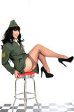 Raunchy Flirtatious Young Vintage Pin Up Model In Military Uniform and Stockings. Attractive raunchy flirtatious Young Vintage Pin-Up Model or woman in royal royalty free stock photo