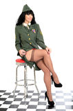 Raunchy Sexy Flirtatious Young Vintage Pin Up Model In Military Uniform and Stockings Royalty Free Stock Photography