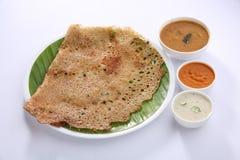 Rava Dosa с чатнями и sambar Стоковое Изображение