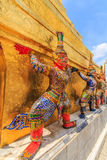 Ravana giant pagoda , a beautiful portrait . The characters in literature Thailand carrying giant golden pagoda in the temple of the Emerald Buddha , also known royalty free stock photo