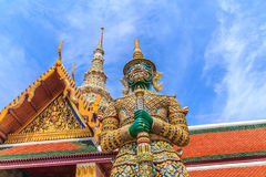 Ravana giant statues guarding the front door horizontal smiling. A giant statue of Ravana Temple of the Emerald Buddha in Thailand Royalty Free Stock Image