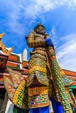Ravana giant statues guarding the front door vertically. A giant statue of Ravana Temple of the Emerald Buddha in Thailand stock images