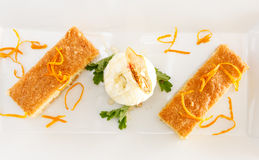 Ravani Cake. In herb syrup with ice cream royalty free stock images