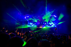 Rave Concert. Disco Party - fantastic green laser show Stock Images