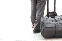 A raveling businessman. I've taken on the road that one of the traveling businessman. I saw that the bag is placed beside him Royalty Free Stock Photography