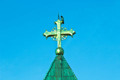 Raven on golden cross on church Royalty Free Stock Photo