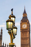 Raven on lampost at Houses of Parliament in early winter morning Stock Photos