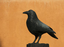 Raven in the Southwest. This Raven forms the subject of a piece of artwork found in Santa Fe, New Mexico Royalty Free Stock Photos