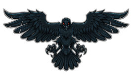 Raven. Stylized flying black raven with the red glowing eyes Royalty Free Stock Image