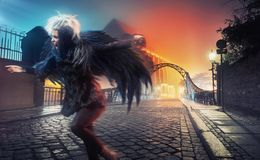 Raven woman. Running on empty city street Stock Images