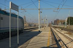 RAVENNA, ITALY: JANUARY 01, 2017-Train at railway platform at winter sunny day Royalty Free Stock Image