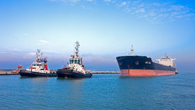 Ravenna, Italy - JANUARY 07, 2015: Tugboat ESPADA and EDUARDO pu Royalty Free Stock Photo