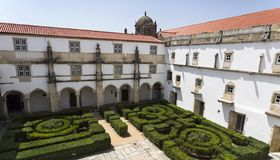 The Ravens Cloister and its garden at the Convent of Christ. The Ravens Cloister was built in mid to late 16th century, it housed a library was used as a retreat royalty free stock photos