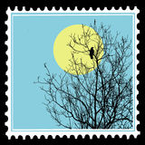 Ravens on tree on postage stamps Royalty Free Stock Photo