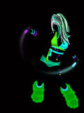 Raver Silhouette. An illustration of a dancing raver with glow sticks in fluorescent clothing Royalty Free Stock Photos