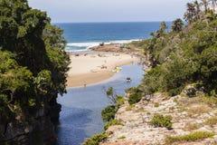 Ravine Cliffs Lagoon Beach. Rugged scenic holiday destination of river ravine cliffs lagoon beach ocean landscape Stock Image