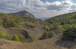 Ravine in the Crimean mountains. Crimean mountains on a sunny day in September. The ravine leading to the sea Royalty Free Stock Photography