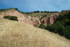 Ravine in a geological reserve. Rapa Rosie, Romania Royalty Free Stock Photo