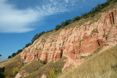 Ravine in a geological reserve. Rapa Rosie, Romania Stock Image