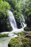 Ravine stream in the Black Mountain Valley. The cascade falls over a tall cliff. Beautiful ravine stream in the Black Mountain Valley Stock Image