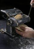 Ravioli 06. Cranking pasta machine Stock Photo