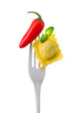 Ravioli basil and chili pepper on a fork Stock Image