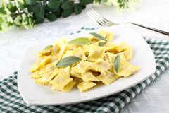 Ravioli with butter and sage. On complex background Stock Photo