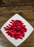 Ravioli with cherry on a wooden background. with copy space. Top view Royalty Free Stock Photos