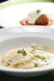 Ravioli in cream sauce Stock Image