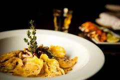 Ravioli Dish. Mushroom Ravioli Dish with fresh herbs Stock Photo