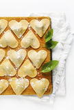 Ravioli in a heart shape. cutting board with a group of raw fres Royalty Free Stock Images