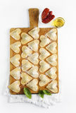 Ravioli in a heart shape. cutting board with a group of raw fres Royalty Free Stock Photography
