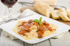 Ravioli. Italian egg pasta with chicken and chorizo filling with creamy tomato and chorizo butter sauce. Garnished with parmigiano-reggiano . Crusty bread Royalty Free Stock Photo