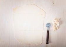 Ravioli and lasagna pastry sheet with cutting wheel. Royalty Free Stock Photo